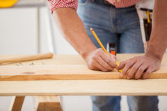 Measuring a wood board Royalty Free Stock Photos