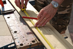 Measuring wood before cutting Stock Photography