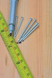 Measuring wood with nails Royalty Free Stock Photo
