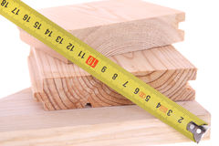 Measuring wood with yellow tape Stock Photography