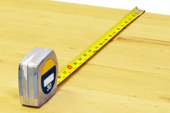 Measuring wooden board Stock Images