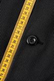 Measurments. Tape Measure with Suit Button Royalty Free Stock Images