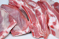 Meat. Fresh pork ribs on light background Stock Photos