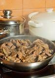 Meat. Juicy pork roast in a pan Royalty Free Stock Image