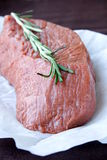 Meat. A large piece of beef tenderloin with rosemary stock photos