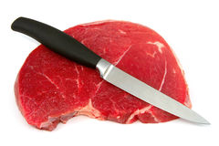 Meat. And knife, on white Stock Photos