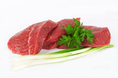 Meat. Raw meat and vegetables on white Royalty Free Stock Photography