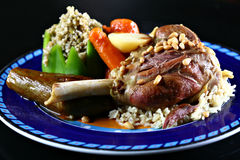 Meat. Osso bucco on a blue plate with rice Royalty Free Stock Images