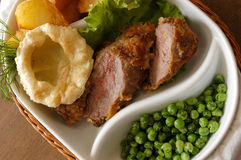 Meat. Fried meat with green peas Stock Photography