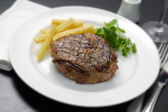 Meat. Roast beef with fried potatoes and vegetables Stock Photography