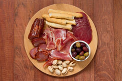 Meat appetizer with olives and nuts Stock Image
