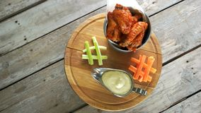 Meat appetizer with sauce. Fried chicken wings in bucket stock footage