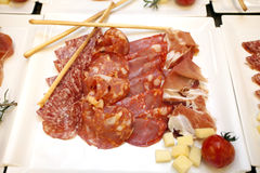 Meat appetizers. Some meat on a plate like appetizers royalty free stock photo