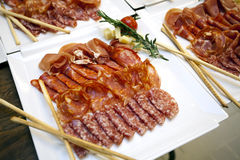 Meat appetizers. Some meat on a plate like appetizers stock photography