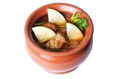 Meat with apples in a clay pot for the menu Stock Photos