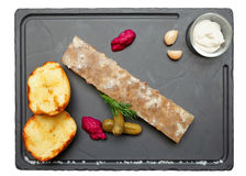 Meat aspic with potatoes and horseradish isolated on black Stock Photo