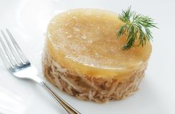 Meat in aspic on white plate closeup Royalty Free Stock Image