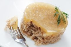 Meat in aspic on white plate closeup Royalty Free Stock Photography