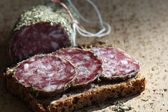 Meat. A baked bread with salami stock photo