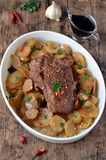 Meat baked with potatoes Stock Photography
