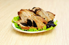 Meat baked with prunes Stock Photography