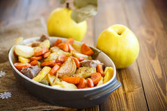 Meat baked with quince Stock Photos