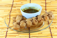 Meat ball grilled with sauce. On bamboo texture background Stock Photography