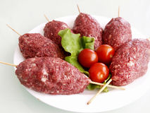 Meat balls. On white plate and tomatoes Stock Images