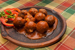 Meat balls. On a clay plate Stock Photos