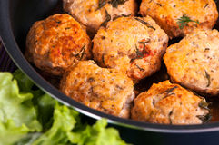 Meat balls. Cooked pork meat balls in a frying pan Stock Photography