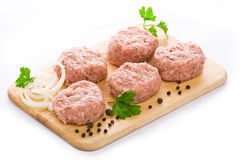 Meat balls arranged on a cutting board Stock Photo