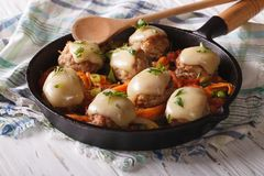 Meat balls baked with cheese and vegetables in the pan. Royalty Free Stock Images