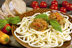 Meat balls  with basil and spaghetti  in ceramic plate on  tablecloth Royalty Free Stock Photography