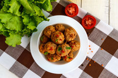 Meat balls with chilli and herbs in a white bowl Stock Images