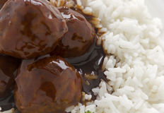 Meat Balls In Hoisin Sauce. Chinese meat balls in hoisin sauce on a bed of white rice with parsley stock image