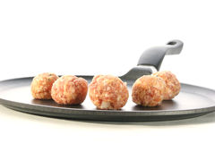 Meat balls in a pan. And a white background Stock Images