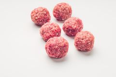 Meat balls from raw beef force-meat on a white. Fresh raw meat balls isolated on white background, close-up Stock Photo