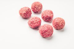 Meat balls from raw beef force-meat on a white. Fresh raw meat balls isolated on white background, close-up Royalty Free Stock Photography