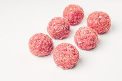 Meat balls from raw beef force-meat on a white. Fresh raw meat balls isolated on white background, close-up Royalty Free Stock Photo
