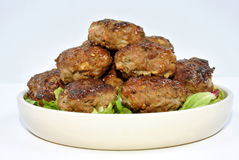 Meat balls and with salad on a plate Stock Photos