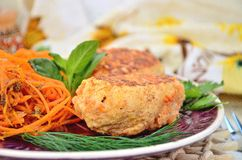Meat Balls. Savory meatballs on a white plate next to a vegetable snack of carrots Royalty Free Stock Image