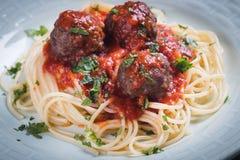 Meat balls with spaghetti pasta and tomato sauce. Meatballs served over italian spaghetti pasta with tomato sauce Royalty Free Stock Photos