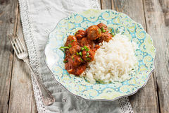 Meat balls in tomato sauce with rice Royalty Free Stock Photography