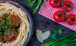 Meat balls with tomato sauce and spaghetti close-up Stock Images