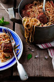 Meat balls in tomato sauce with spaghetti. Stock Image