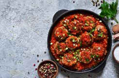 Meat balls in tomato sauce with spices concrete background. View from above royalty free stock photo
