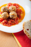 Meat balls on tomato sauce. With white bread Stock Photos