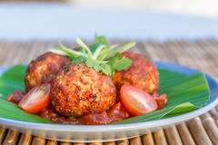 Meat balls with tomato served on palm leaf Stock Photos