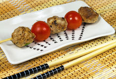 Meat balls and tomatoes Stock Images