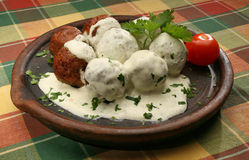 Meat balls with white sauce 2. Meat balls on a clay plate Royalty Free Stock Photo